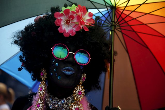 A reveller poses for a photo during the LGBT Pride Parade in Copacabana beach in Rio de Janeiro, Brazil, November 15, 2015. (Photo by Pilar Olivares/Reuters)