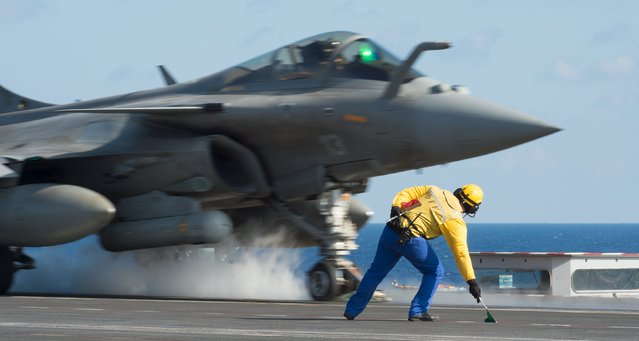 A rafale aircraft takes-off from the nuclear-powered aircraft carrier Charles de Gaulle during operations in the Mediterranean Sea in this picture released November 23, 2015, after a series of deadly attacks in the French capital on November 13. France's Charles de Gaulle aircraft carrier is deployed to support operations against Islamic State in Syria and Iraq. (Photo by Reuters/ECPAD)