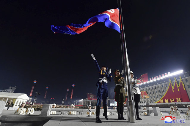 In this photo provided by the North Korean government a North Korean flag is hoisted in the celebration for the ruling party congress, at Kim Il Sung Square in Pyongyang, North Korea Thursday, January 14, 2021. (Photo by Korean Central News Agency/Korea News Service via AP Photo)