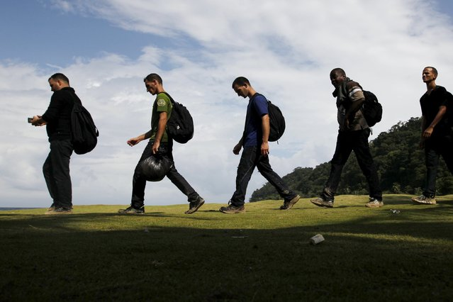 Cuban migrants walk as they arrive after crossing the border from Colombia through the jungle into La Miel, in the province of Guna Yala, Panama November 29, 2015. (Photo by Carlos Jasso/Reuters)