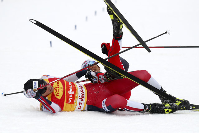 Jarl Magnus Riiber of Norway, foreground, and Akito Watabe of Japan lie on the ground after crossing the finish line during the men's Individual Gundersen NH 5km ski jumping competition at the Nordic Combined World Cup in the Austrian province of Tyrol, in Seefeld, Austria, Friday, January 29, 2021. (Photo by Matthias Schrader/AP Photo)