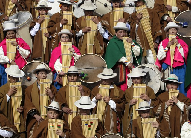 Indigenous musicians play native instruments such as the zampona during an Andean ceremony with Bolivia's President Evo Morales (not pictured) in Tiahuanaco some 70 km from La Paz, January 21, 2015. (Photo by David Mercado/Reuters)