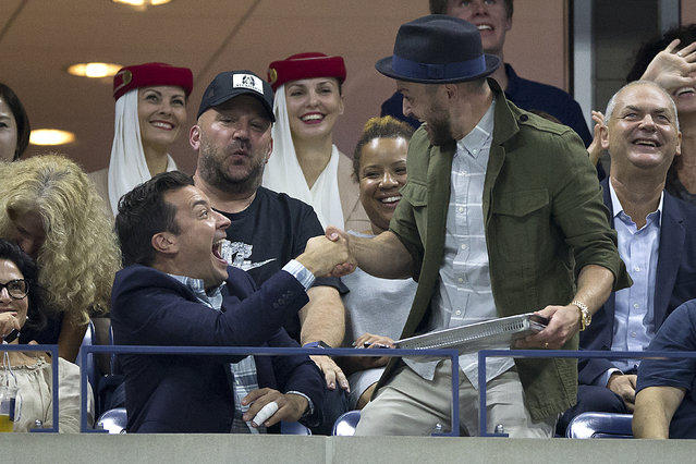 Jimmy Fallon and Justin Timberlake play around as they are shown on a video screen at the quarterfinals match between Roger Federer of Switzerland and Richard Gasquet of France at the U.S. Open Championships tennis tournament in New York, September 9, 2015. (Photo by Carlo Allegri/Reuters)