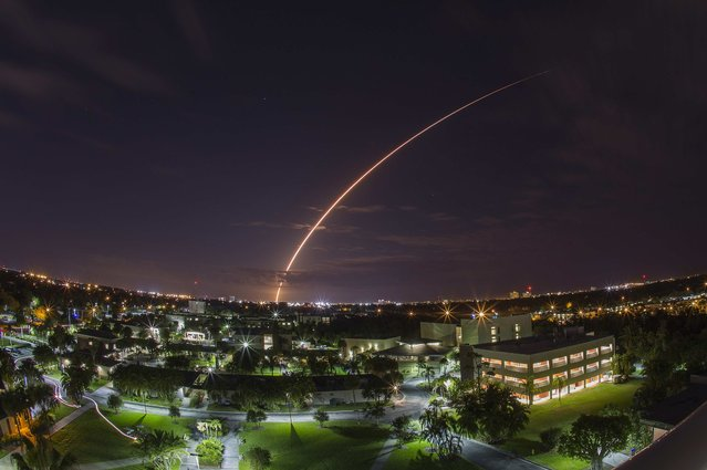 A United Launch Alliance Atlas V 551 rocket blasts off from Cape Canaveral Air Force Station in Florida, January 20, 2015. The unmanned rocket blasted off with a next-generation communications satellite designed to provide cellular-like voice and data services to U.S. military forces around the world. Picture taken using long exposure, looking over the campus of Florida Institute of Technologies in Melbourne, about 40 miles from the launch pad. (Photo by Michael Brown/Reuters)