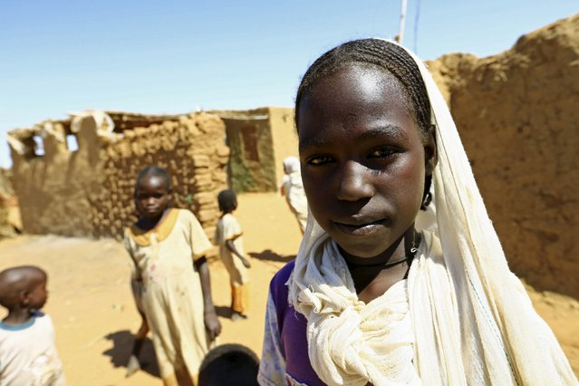 Nidaa Abdallah poses for a photograph in Al-Salam camp in Darfur, Sudan, November 17, 2015. Born in the camp, 12-year-old Nidaa wishes to be an engineer in her adulthood. (Photo by Mohamed Nureldin Abdallah/Reuters)