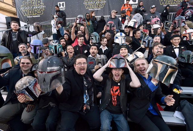 "Fans cheer in the stands at Los Angeles premiere of ""Star Wars: The Force Awakens"" at the TCL Chinese Theatre on Monday, December 14, 2015, in Los Angeles. (Photo by Jordan Strauss/Invision/AP Photo)"