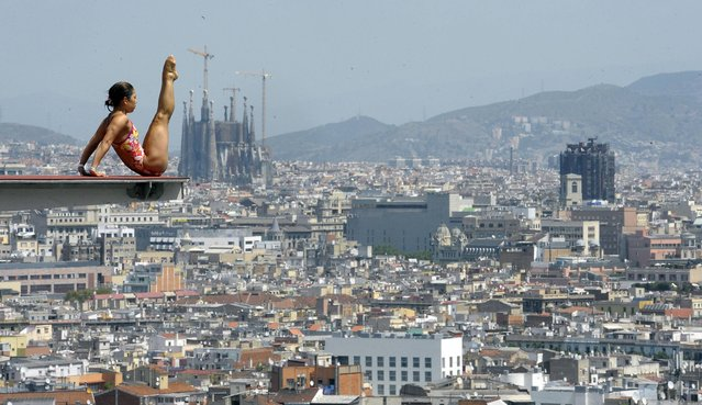 The Sagrada Familia cathedral is seen in the background as an unidentified diver practices ahead of the FINA World Championships in Barcelona, Spain, Monday, July 15, 2013. The FINA swimming World Championships run from July 19 to August 4 in Barcelona. (Photo by Manu Fernandez/AP Photo)