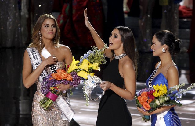 Miss Universe 2014 Paulina Vega (C) speaks to the audience as she transfers the crown from Miss Colombia Ariadna Gutierrez (L) to winner Miss Philippines Pia Alonzo Wurtzbach during the 2015 Miss Universe Pageant in Las Vegas, Nevada December 20, 2015. Miss Colombia was originally announced as the winner but host Steve Harvey said he made a mistake when reading the card. (Photo by Steve Marcus/Reuters)