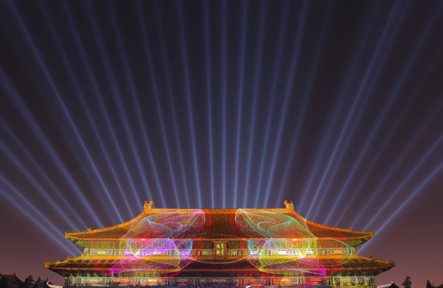 The Imperial Ancestral Temple was lit up in holiday decorations and red lights during a rehearsal for a New Year's Eve countdown celebration in Beijing, China, 30 December 2015. The Imperial Ancestral Temple was lit up in holiday decorations and red lights during a rehearsal for a New Year's Eve countdown celebration in Beijing, on Wednesday (30 December 2015). About 1,000 tourists from home and abroad will participate in the celebration. At 8 hours ahead of Greenwich Mean Time, China will ring in 2016 ahead of much of the rest of the world on Thursday night. (Photo by Imaginechina/Splash News)