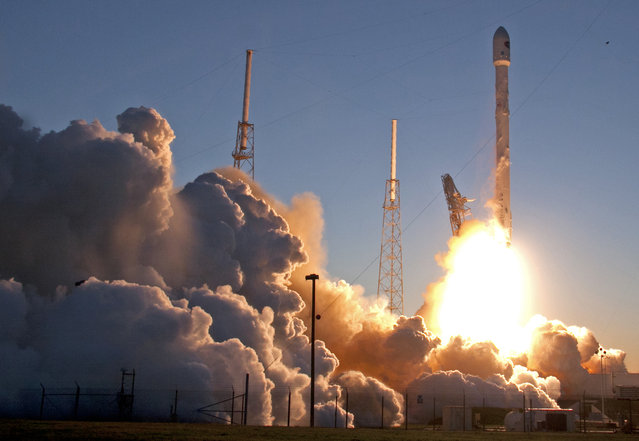 An unmanned Falcon 9 SpaceX rocket lifts off from launch complex 40 at the Cape Canaveral Air Force Station, Wednesday, February 11, 2015, in Cape Canaveral, Fla. On board is the Deep Space Climate Observatory, which will head toward a solar-storm lookout point a million miles away. (Photo by John Raoux/AP Photo)