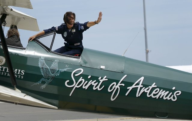 British aviator Tracey Curtis-Taylor celebrates her arrival at Sydney's International Airport in an open cockpit biplane, January 9. 2016. (Photo by Jason Reed/Reuters)