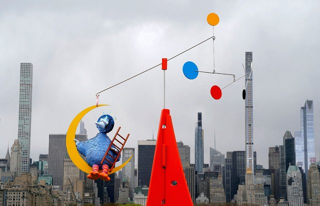 """Philadelphia-based artist Alex Da Corte's """"As Long as the Sun Lasts"""" a 26-foot-tall (8-meter) kinetic sculpture featuring the Sesame Street character Big Bird and the modern aesthetic of Alexander Calder's standing mobiles is on display April 16, 2021, for The Met's 2021 Roof Garden Commission. The exhibition at the Iris and B. Gerald Cantor Roof Garden will be on view April 16 through October 31, 2021. (Photo by Timothy A. Clary/AFP Photo)"""