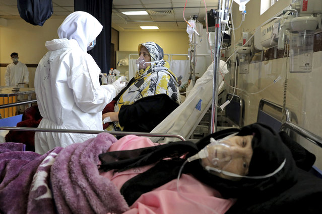 A nurse tends to a patient affected by the COVID-19 virus at the Shohadaye Tajrish Hospital in Tehran, Iran, Saturday, April 17, 2021. After facing criticism for downplaying the virus last year, Iranian authorities have put partial lockdowns and other measures in place to try and slow the coronavirus' spread. (Photo by Ebrahim Noroozi/AP Photo)