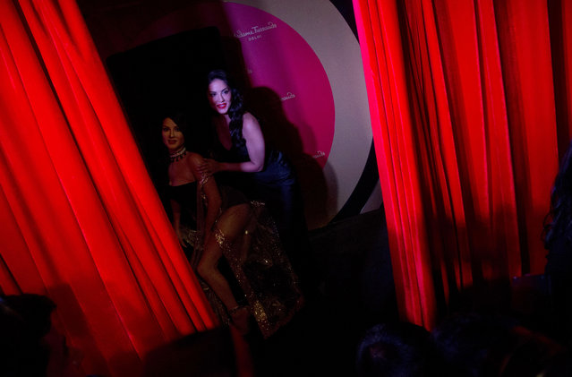Bollywood actress and former p*rn star Sunny Leone stands with her wax likeness during its unveiling at the Madame Tussauds museum in New Delhi, India, Tuesday, September 18, 2018. The statue unveiled Tuesday represents the 37-year-old celebrity's acceptance by mainstream Indian society even as conservative Indian politicians condemn her p*rn-star past. (Photo by Anupam Nath/AP Photo)
