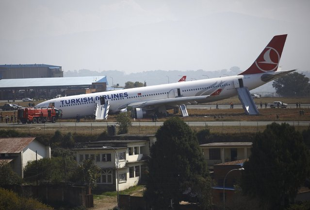 A Turkish Airlines plane lies on the field after it overshot the runway at Tribhuvan International Airport in Kathmandu March 4, 2015. According to local media, all passengers were rescued. REUTERS/Navesh Chitrakar