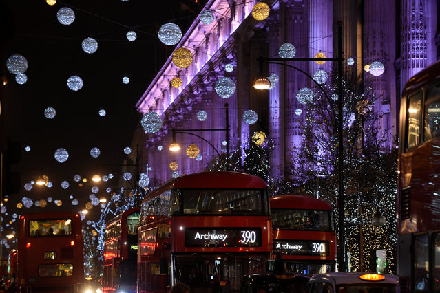 London buses travel past Christmas lights on Oxford Street in London, Britain December 9, 2016. (Photo by Clodagh Kilcoyne/Reuters)