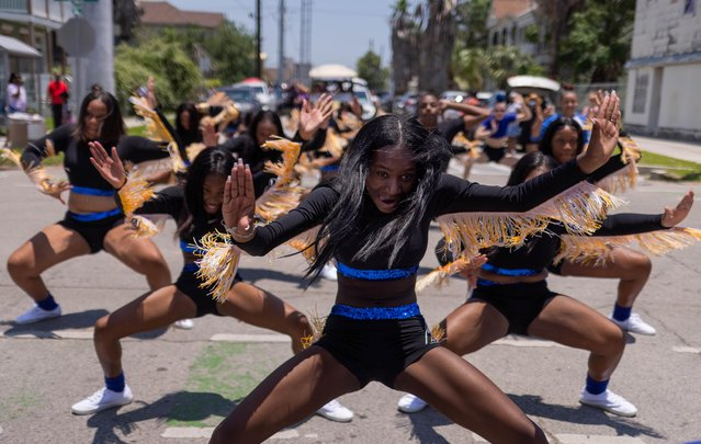 Members of the Texas Dancin' Divas take part in the Juneteenth Parade in Galveston, Texas, U.S., June 19, 2021. The United States marked Juneteenth for the first time as a federal holiday commemorating the end of the legal enslavement of Black Americans. (Photo by Adrees Latif/Reuters)