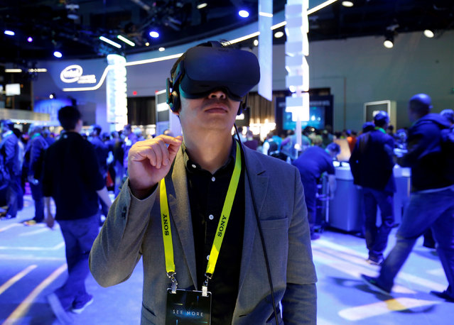Summer Tan of China tries out a Oculus Rift virtual reality headset at the Intel booth during the 2017 CES in Las Vegas, Nevada January 5, 2017. (Photo by Steve Marcus/Reuters)