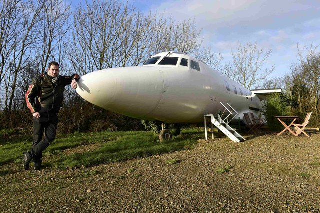 Owner Toby Rhys-Davies stands outside his luxury Jetstar private jet, built in the seventies and retaining most of the original features which is now being used as a holiday let in Redberth, Pembrokeshire, Wales, January 11, 2017. (Photo by Rebecca Naden/Reuters)