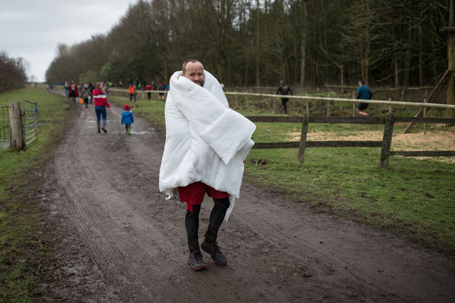 A competitor leaves the course having taken part in the Tough Guy endurance event near Wolverhampton, central England, on January 27, 2019. The Tough Guy event challenges hundreds of competitors to run a gruelling course whilst negotiating up to 300 obstacles including water, fire, and tunnels. (Photo by Oli Scarff/AFP Photo)