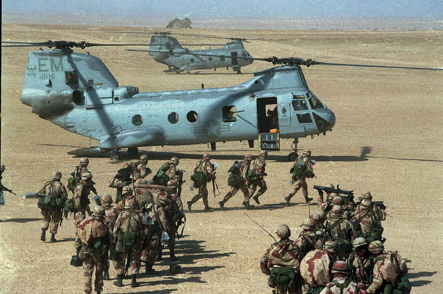 In this February 12, 1991 file photo, U.S. Marines prepare to board Chinook CH-46 helicopters during a deployment exercise in the desert of Saudi Arabia during the Persian Gulf crisis. Twenty five years after the first U.S. Marines swept across the border into Kuwait in the 1991 Gulf War, American forces find themselves battling the extremist Islamic State group, born out of al-Qaida, in the splintered territories of Iraq and Syria. (Photo by Sadayuki Mikami/AP Photo)
