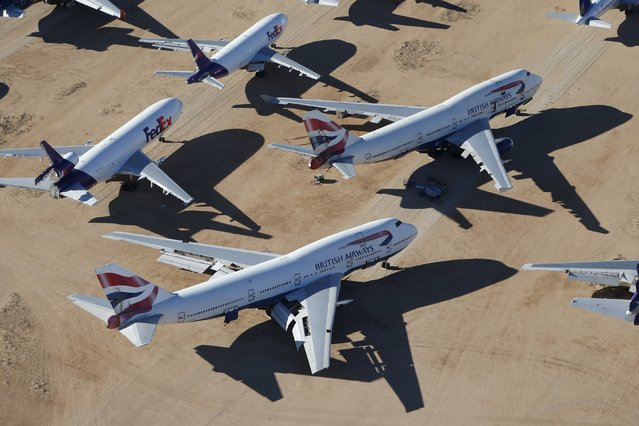 Old airplanes, including British Airways Boeing 747-400s and FedEx planes, are stored in the desert in Victorville, California March 13, 2015. (Photo by Lucy Nicholson/Reuters)