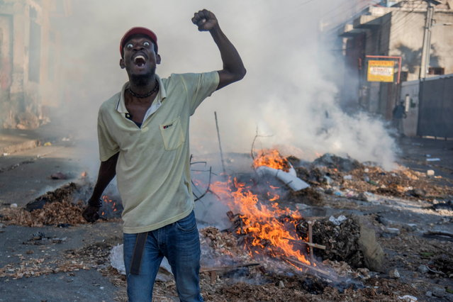 People participate in a protest in Port-au-Prince, Haiti, 09 February 2019. Tension remains high in Haiti after the massive protest held on 07 February against the country's president, Jovenel Moise, and mobilizations called by the opposition continue despite the call for calm and dialogue by the president. (Photo by Jean Marc Herve Abelard/EPA/EFE)