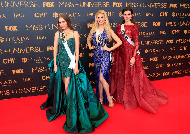 Miss Universe candidates - Miss Russia Yuliana Korolkova, Miss Slovenia Lucija Potocnik and Miss Ukraine Alena Spodynyuk pose for a picture during a red carpet inside a SMX convention in metro Manila, Philippines January 29, 2017. (Photo by Romeo Ranoco/Reuters)