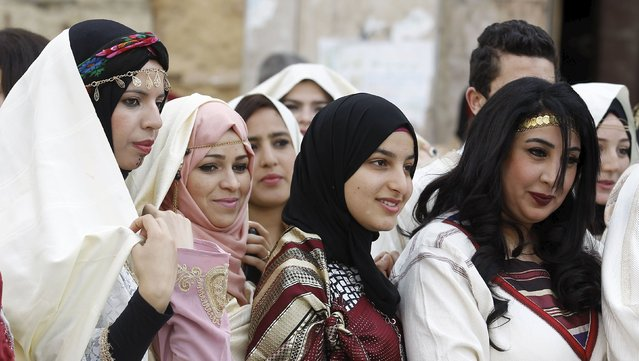Women wear traditional costumes on the National Day of Crafts and Traditional Dress in Tunis, Tunisia March 20, 2016. (Photo by Zoubeir Souissi/Reuters)
