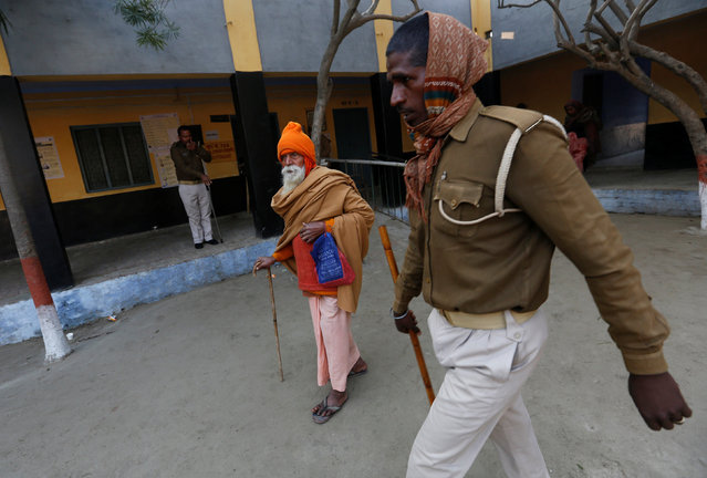 A Sadhu or a Hindu holy man leaves after casting his vote at a polling booth during the state assembly election in Garhmukteshwar, in the central state of Uttar Pradesh, India, February 11, 2017. (Photo by Adnan Abidi/Reuters)