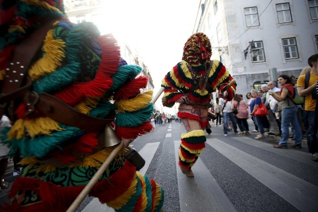 """Members of the """"Caretos de Podence"""" folk group perform during the parade of the 10th International Festival of the Iberian Mask in Lisbon, Portugal May 9, 2015. (Photo by Rafael Marchante/Reuters)"""