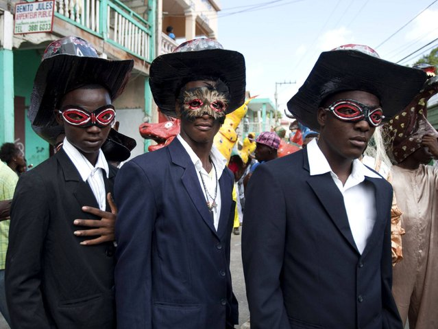 Revelers in costume perform during the Carnival parade in Jacmel, Haiti, Sunday, February 23, 2014. The Carnival spirit took hold as Jacmel's annual parade snaked through the downtown of this coastal town revered among Haitians for its artists and artisans. (Photo by Dieu Nalio Chery/AP Photo)