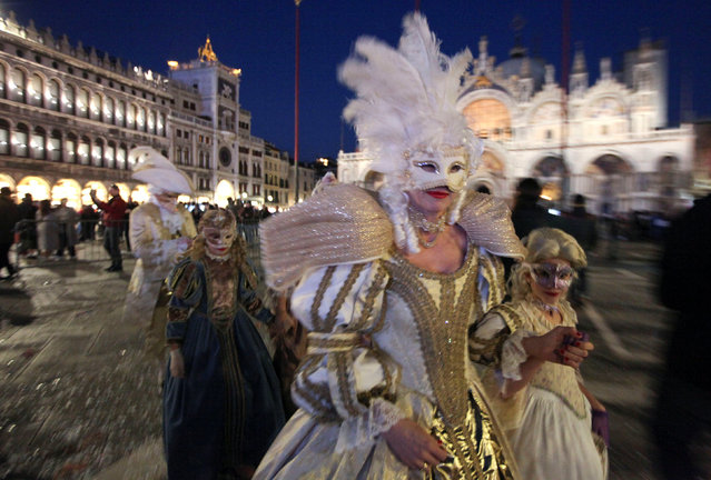 Masked revellers walk on St. Mark's Square during the Venice Carnival in Venice, Italy February 18, 2017. (Photo by Fabrizio Bensch/Reuters)
