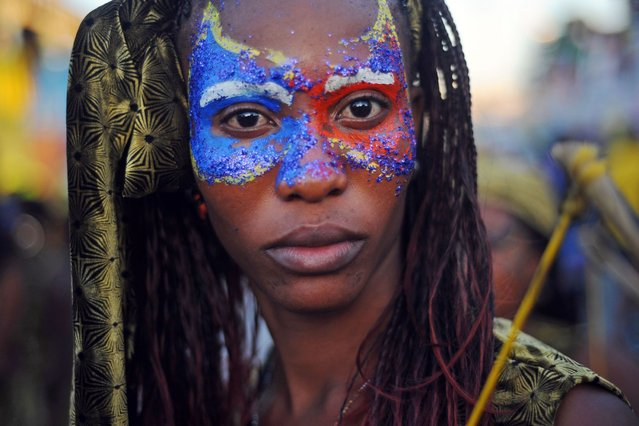 A reveler poses during the last day of National Carnival parade 2014, in Gonaives, some 150 km from Port au Prince on March 4, 2014 in Haiti. (Photo by Hector Retamal/AFP Photo)