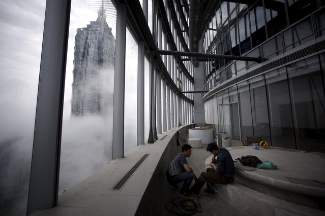 Worker work inside the Shanghai Tower, at the financial district of Pudong in Shanghai May 15, 2015. (Photo by Aly Song/Reuters)