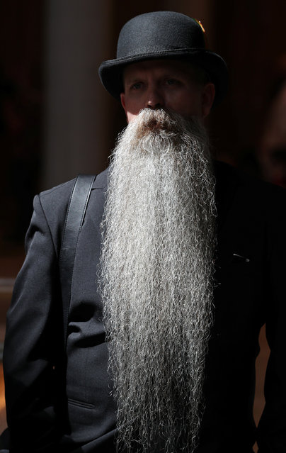 A participant of the international World Beard and Moustache Championships poses before taking part in one of the 17 categories of beard and moustache styles competing in Antwerp, Belgium May 18, 2019. (Photo by Yves Herman/Reuters)