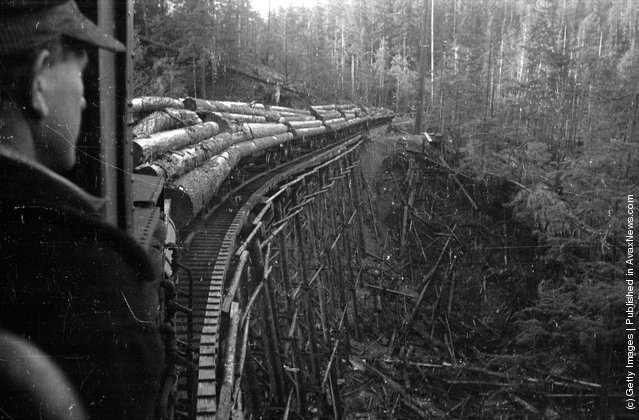 1939: A logger transports timber to the river on a skeletal railway  in the forests of British Columbia, Canada