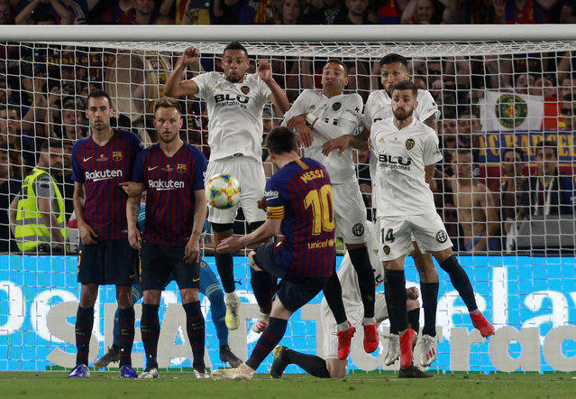 Barcelona forward Lionel Messi takes a free kick during the Copa del Rey soccer match final between Valencia CF and FC Barcelona at the Benito Villamarin stadium in Seville, Spain, Saturday. 25, 2019. (Photo by Miguel Morenatti/AP Photo)