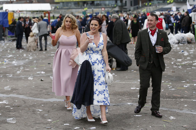 Racegoers leave after Ladies Day of the Crabbie's Grand National Festival at Aintree Racecourse on April 8, 2016 in Liverpool, England. (Photo by Andrew Yates/Reuters/Livepic)