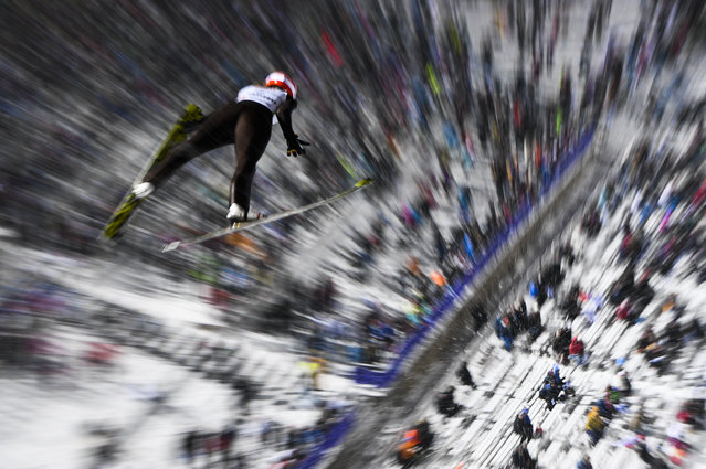Svenja Wuerth of Germany soars during the mixed normal hill team event of the 2017 FIS Nordic World Ski Championships in Lahti, Finland, on February 26, 2017. Germany won, Austria placed second and Japan placed third. (Photo by Jonathan Nackstrand/AFP Photo)
