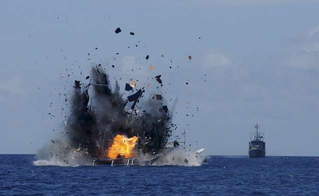 The Indonesian navy scuttles foreign fishing vessels caught fishing illegally in Indonesian waters near Bitung, North Sulawesi May 20, 2015 in the is photo taken by Antara Foto. A total of 19 foreign boats from Vietnam, Thailand, Philippines and one from China were destroyed near Bitung as part of an ongoing crackdown by the Indonesian government on illegal fishing. (Photo by Fiqman Sunandar/Reuters/Antara Foto)