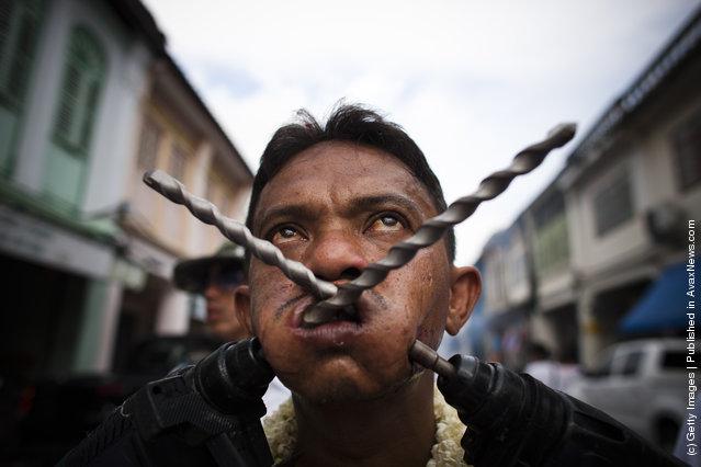 Devotees Practice Self Mutilation At Phuket Vegetarian Festival
