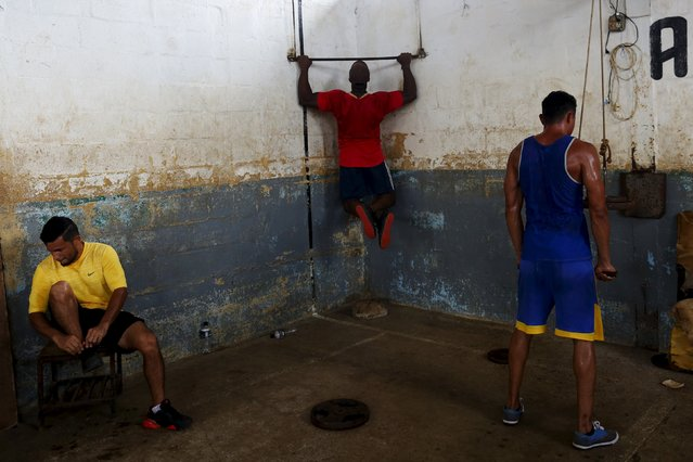 Inmates work out at the Pavilion No.6 assigned to foreigners at La Joya prison on the outskirts of Panama City, Panama November 13, 2015. (Photo by Carlos Jasso/Reuters)