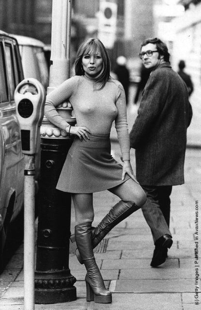 Susan Shaw models a mini skirt and platform boots, 1975