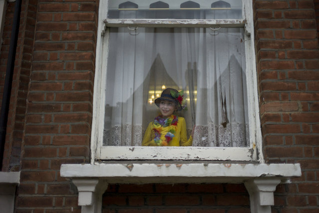 A young Jewish looks from a window during the annual Jewish holiday of Purim on March 12, 2017 in London, England. (Photo by Dan Kitwood/Getty Images)