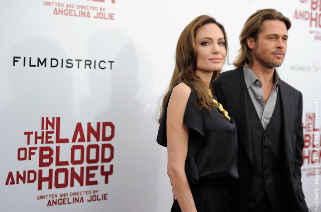 Director/actor Angelina Jolie and actor Brad Pitt pose for a photo during the premiere of In the Land of Blood and Honey at the School of Visual Arts