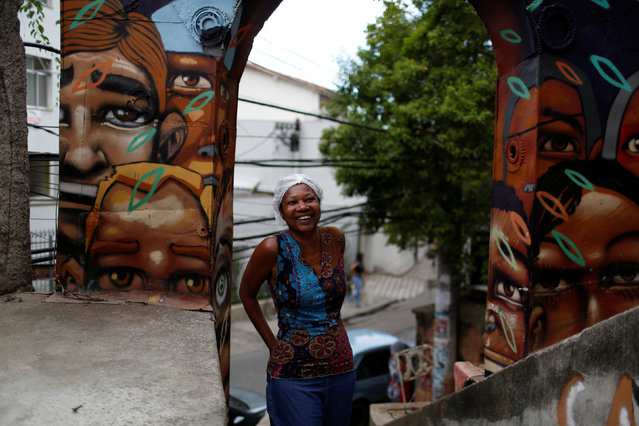 Ligia, the owner of Pousada Favela Cantagalo hostel, poses for a photograph near her hostel in Cantagalo favela, in Rio de Janeiro, Brazil, May 1, 2016. (Photo by Pilar Olivares/Reuters)