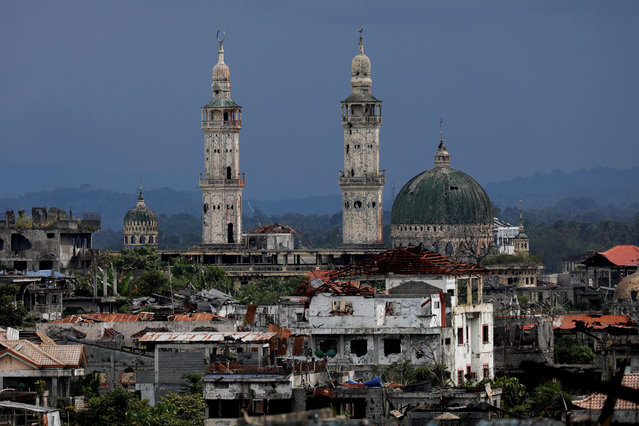 Dilapidated structures are seen at the most affected war-torn area of Marawi City, Lanao del Sur province, Philippines, May 11, 2019. The area remains abandoned two years since pro-Islamic State militants began their attacks on May 23, 2017. Marawi was once one of the most picturesque cities in the Philippines. About half of it is now charred concrete and skeletons of buildings, the effects of 154 days of air strikes and artillery by the military, and booby traps the rebels laid everywhere to keep them at bay. (Photo by Eloisa Lopez/Reuters)