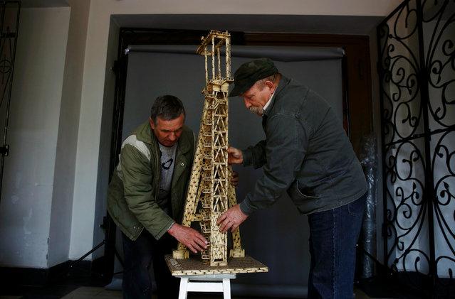 Janusz Urbanski holds a matchstick replica of mine shaft in Ruda Slaska, Poland May 4, 2016. (Photo by Kacper Pempel/Reuters)