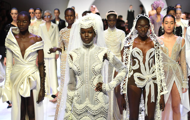 Adut Akech showcases a J'Aton Couture design during the Opening Town Hall Runway at Melbourne Fashion Week at Melbourne Town Hall on August 30, 2019 in Melbourne, Australia. (Photo by Julian Smith/AAP)